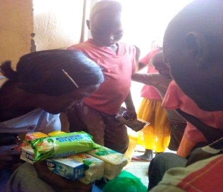 The supported children receive their personal items at Eruba primary school.