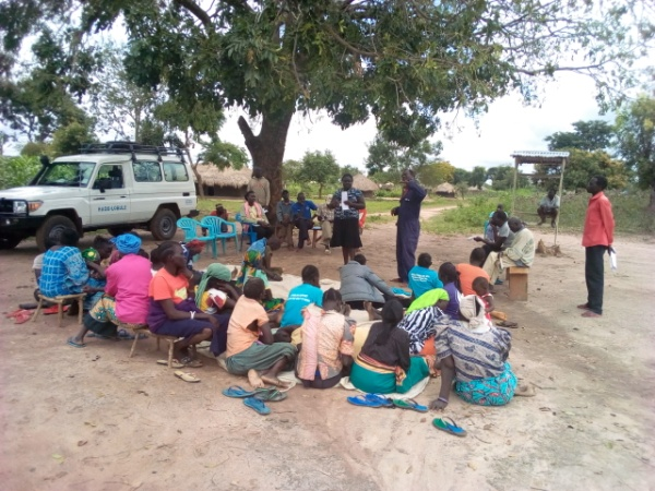 The community of Adologo in a meeting where issues like child protection, gender and violence were discussed.