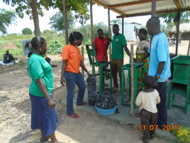 Briquettes made by a man in the red T-shirt for sale to HADS staff.