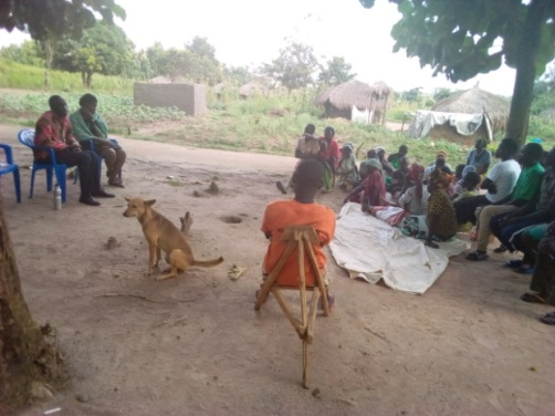 Community memebers  attending a session on drug & substance abuse and conflict resolution in Waju III village respectively